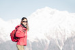 Backpacker girl on background of winter mountains.