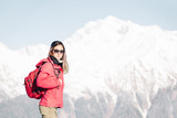Backpacker girl on background of winter mountains. - 183006534