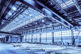 Unified standard typical span prefabricated of a steel frame production building. Industrial metalwork production hall with overhead cranes. Background in blue tone - 183011111