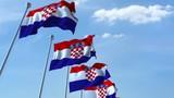 Multiple waving flags of Croatia against the blue sky, seamless loop - 183014972