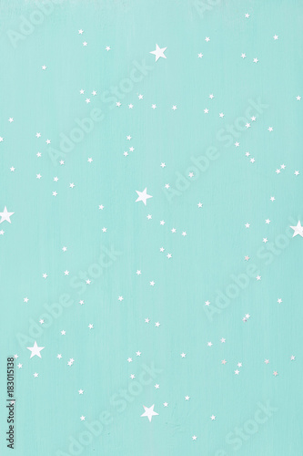 Staande foto Heelal turquoise wooden background with small shinny silver stars