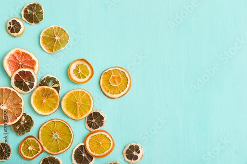 Poster Top view on handmade citrus chips: orange, lemon, grapefruit on turquoise wooden background