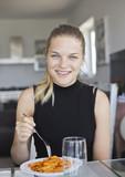 Smiling girl eating for lunch - 183015329