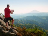 Lost tourist  on peak looking into landscape  while check paper map, hiking  in nature. - 183016591