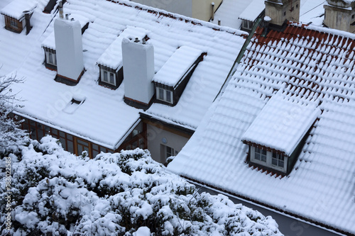 Fototapeta The Look on the snowy Roofs of the old gothic Town Prague