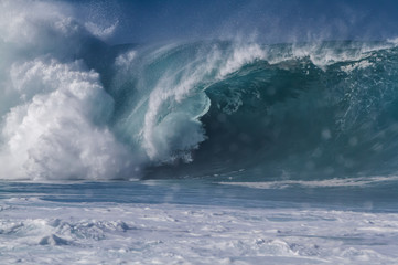 Giant breaking wave on the north shore of Oahu Hawaii at Waimea bay