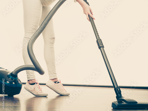Woman legs and vacuum cleaner - 183026162