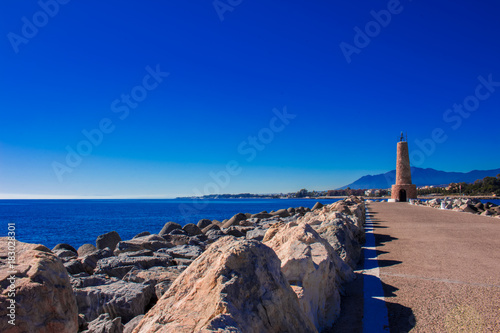 Canvas Donkerblauw Lighthouse. Port of Puerto Banus, Marbella, Costa del Sol, Andalusia, Spain.