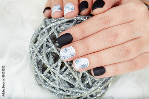 Foto op Plexiglas Manicure Hands with short manicured nails colored with black and white nail polish