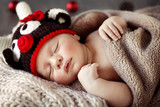 Cute baby sleeping in Christmas pajamas - 183030329