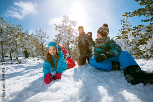 Ski, snow sun and fun - family enjoying winter vacations