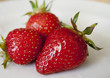 ripe strawberry on a plate