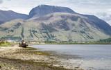 View across Loch Linnhe beyond an abandoned boat towards Ben Nevis - 183057518