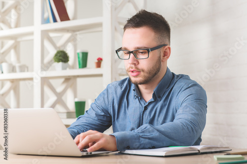Young businessman working on project