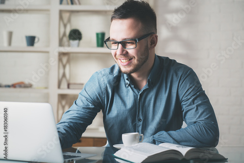 White businessman working on project