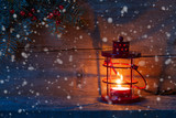 Christmas lantern in dusk on old wooden background. - 183061123