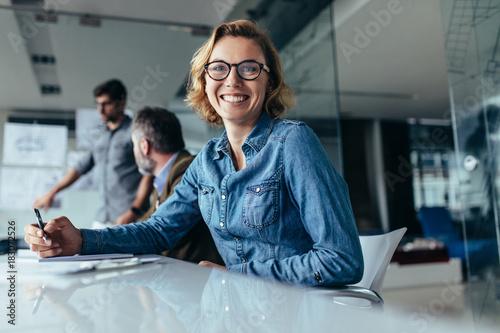 Foto Murales Female office worker  sitting in board room