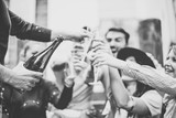 Multiracial group of young friends having fun drinking and toasting glasses of champagne on university stairs - Happy people celebrating graduation with a bottle of prosecco in city outdoor - 183078356