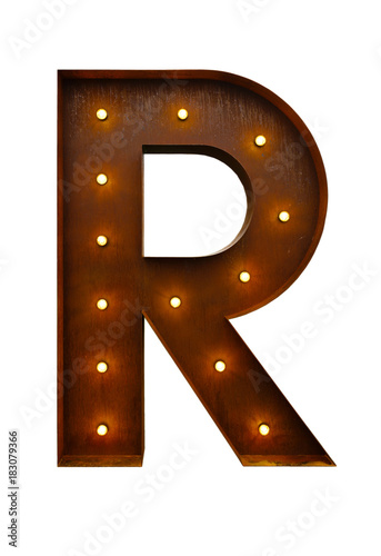 Foto Murales Rusty metal letter R with led light bulbs isolated on white background.