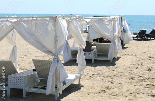 Fototapeta exclusive luxury beach in the tropical resort with umbrellas and