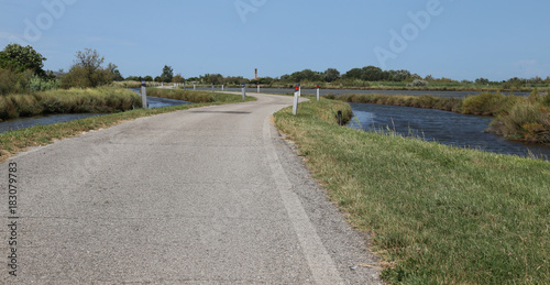 Fototapeta narrow winding road in the middle of the lagoon near Venice in I