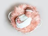 Newborn little girl sleeps on fluffy blanket - 183080540