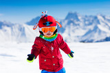 Kids winter snow sport. Children ski. Family skiing. - 183083119