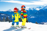 Ski and snow winter fun for kids. Children skiing. - 183088583