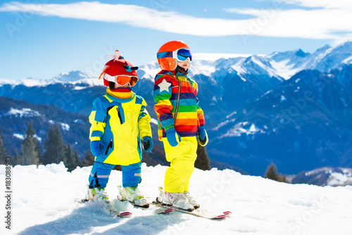 Ski and snow winter fun for kids. Children skiing. - 183088583