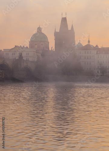 Fotobehang Zwaan Beautiful morning in Prague. Charles Bridge and Vltava River at dawn