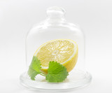fresh flawless lemon with a mint leaf inside the glass jar on white background - 183088902