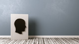 Book with Human Head Shape on Wooden Floor, Biography Concept - 183104135