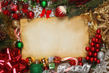 Blank paper surrounded by Christmas ornaments, decorations, and tree branches - 183110183