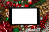 Blank tablet surrounded with Christmas decorations - 183110191