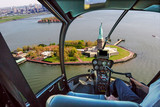 Helicopter flight view of Liberty Island and the famous Statue of Liberty monument symbol of New York City, United States. - 183115597