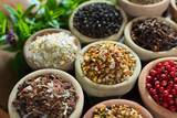 Variety of different asian and middle east spices, colorful assortment, on old wooden table - 183118373