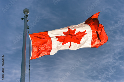 Fotobehang Canada Flag of Canada flying against a blue sky in Vancouver, BC, Canada