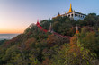 The temple on Mandalay Hills in Mandalay during the sunset in Myanmar.