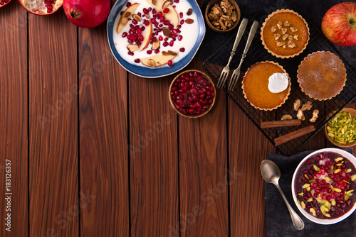assorted of fall foods and desserts on wooden background. healthy eating. vegan. top view. copy space.