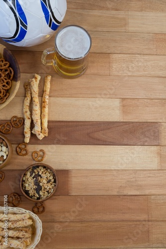 Poster Fresh snacks and beer on wooden table