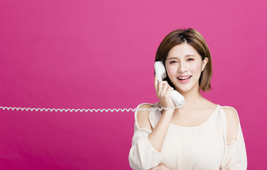 Young Beautiful Woman Talking On the Phone.