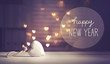 Happy New Year message with a white heart with heart shaped lights