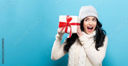 Fototapeta Young woman holding a Christmas gift box