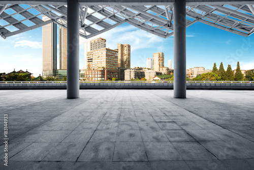 cityscape of modern city at dawn from empty floor - 183144933