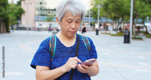 Senior woman use of cellphone at outdoor