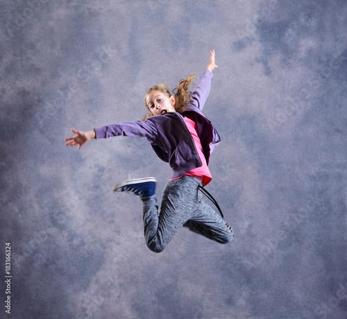 Fototapeta blond girl dancing and jumping
