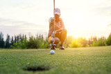 Motion blur golfers hit sweeping and keep golf course in the summer for relax time