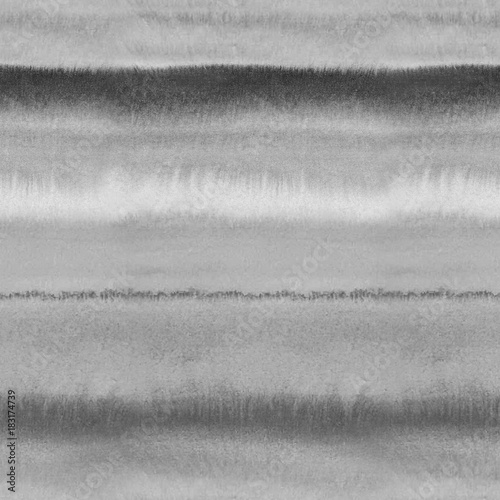 Materiał do szycia Black and white monochrome wet watercolor background. Seamless pattern with art grey color blurred repeat straight stripes texture. Hand painting brush strokes abstract pattern.