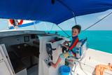Boy drives catamaran - 183197754