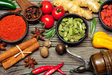 Spices and herbs on wooden background - 183202568